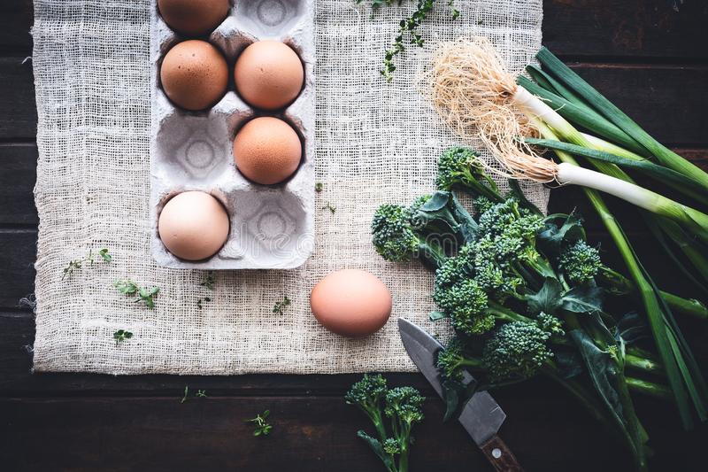 Ingredient for Leeks, Broccoli Eggs Frittata with Parmesan Cheese. stock photos