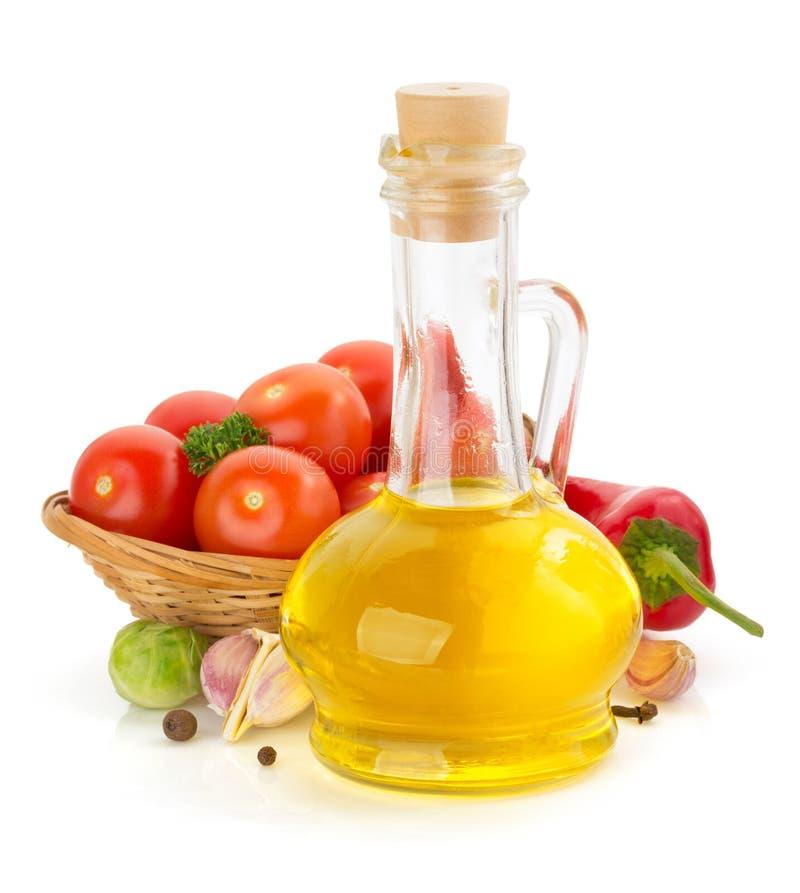 Ingredientes do óleo e de alimento, especiaria no branco fotografia de stock