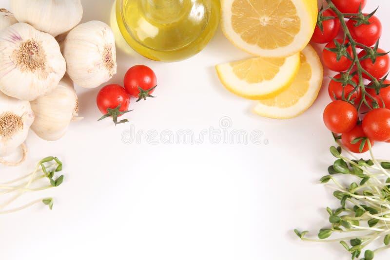 Ingredientes en blanco foto de archivo