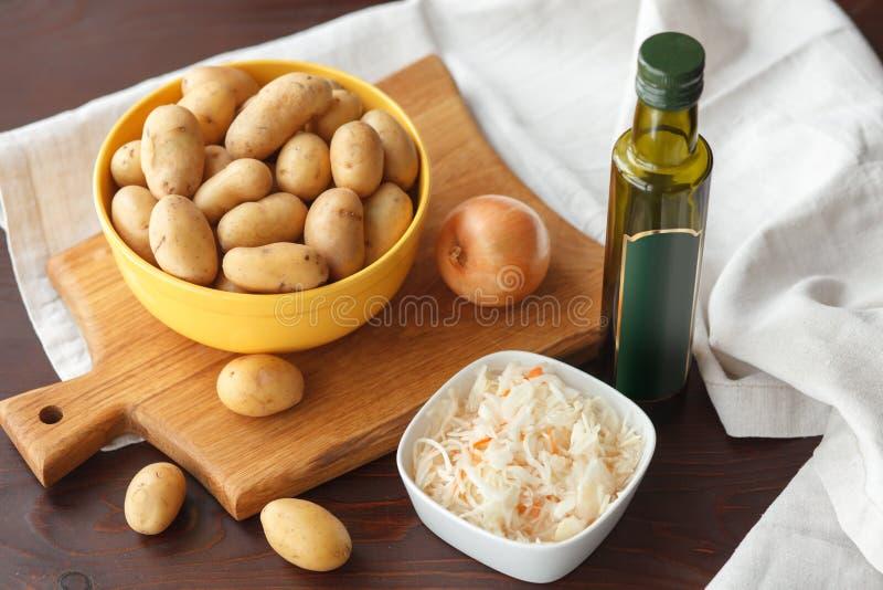 Ingredientes para la patata frita con la chucrut imagen de archivo libre de regalías