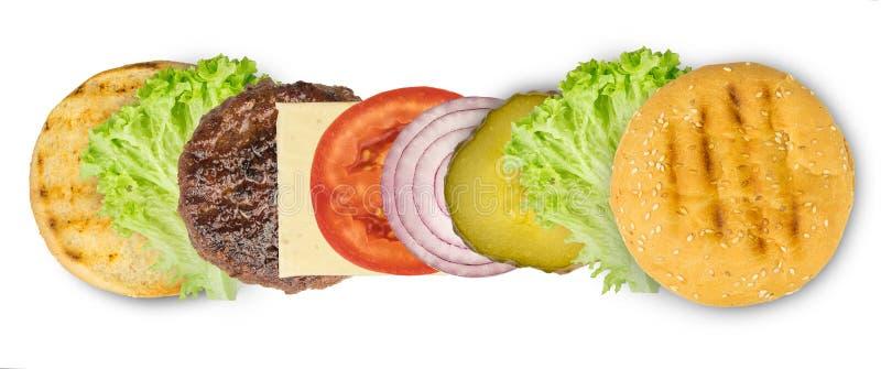 Ingredienti per produrre hamburger isolato sul fondo bianco fotografia stock