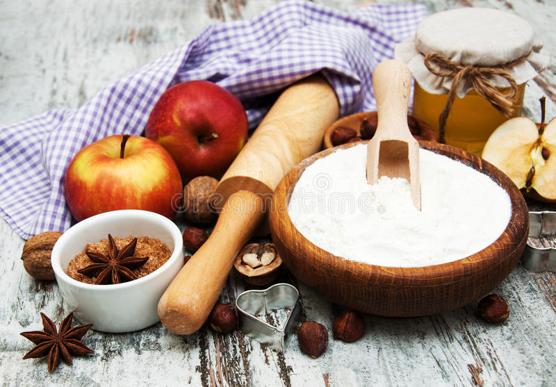 Ingredients for apple pie - red apple, butter, flour, brown sugar, nuts and spices royalty free stock photos