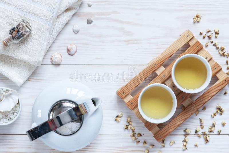 Ingredients for aromatherapy and spa, aromatic sea salt and towels Chinesse tea. Natural cosmetics, Spa kit for beauty and royalty free stock photography