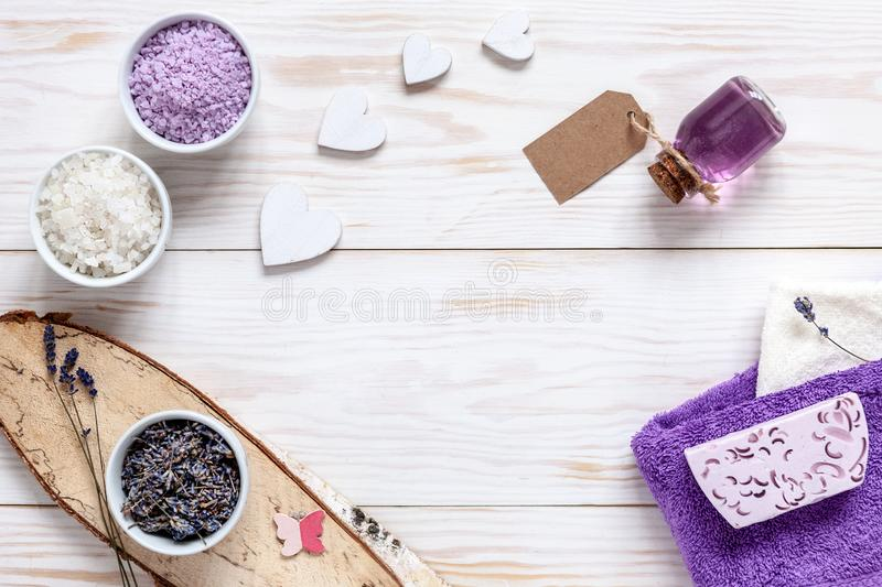 Ingredients for aromatherapy and spa, aromatic sea salt and towels. Natural cosmetics, Spa kit for beauty and health on a white. Wooden background. Close up stock photography