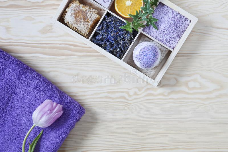 Ingredients for aromatherapy and spa, aromatic sea salt and towels. Natural cosmetics, Spa kit for beauty and health on a white stock photo