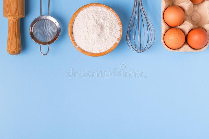 Ingredients for baking on a blue background. royalty free stock photography