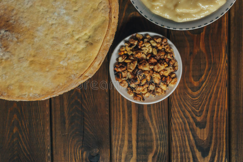 Ingredients for baking a cake, top view on wooden board. shortcakes, buttercream stock image