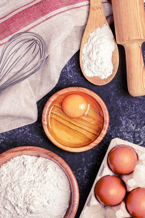 Ingredients for baking  - flour, wooden spoon, rolling pin, eggs stock image