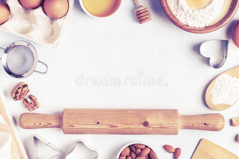 Ingredients for baking  - flour, wooden spoon, eggs royalty free stock photo