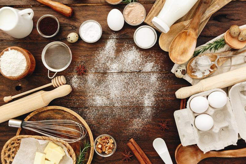 Ingredients for baking and kitchen utensils. Flour, eggs, sugar royalty free stock images
