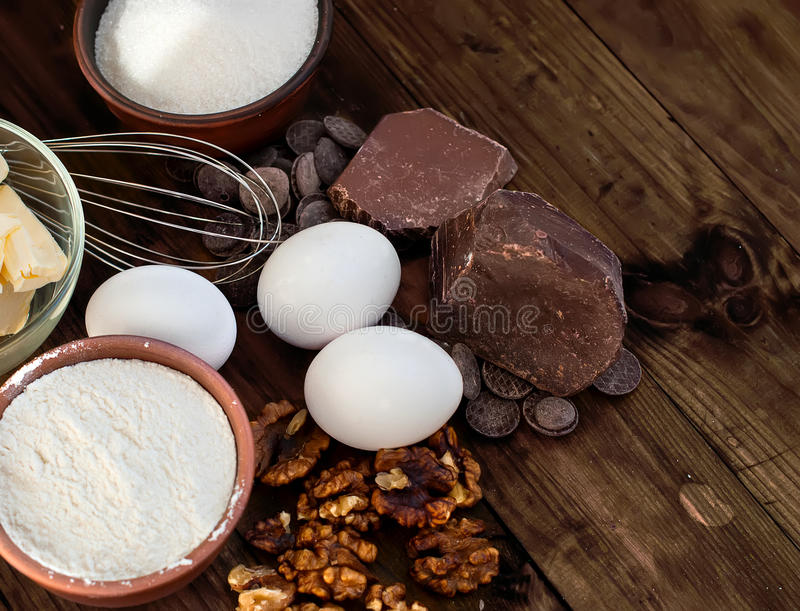 Ingredients for a batch of homemade chocolate cake brownie. Flour, butter, sugar, eggs, chocolate - ingredients for a batch of homemade chocolate cake brownie royalty free stock images