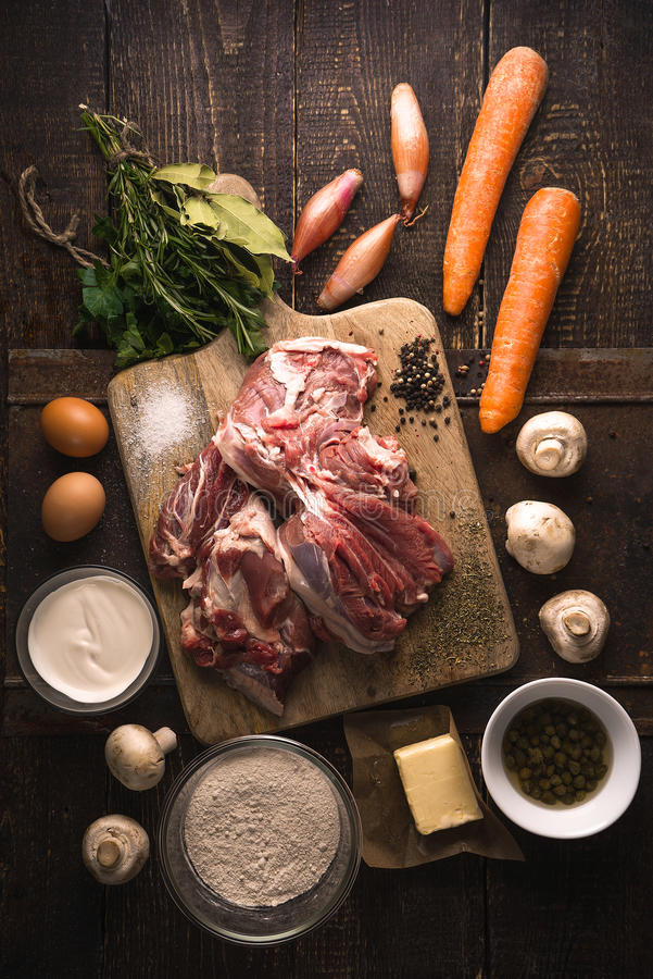 Ingredients for blanquette on the wooden table vertical royalty free stock photos