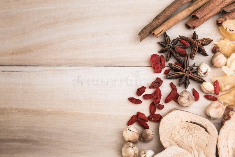 Ingredients for Chinese herbal soup on wooden background stock image