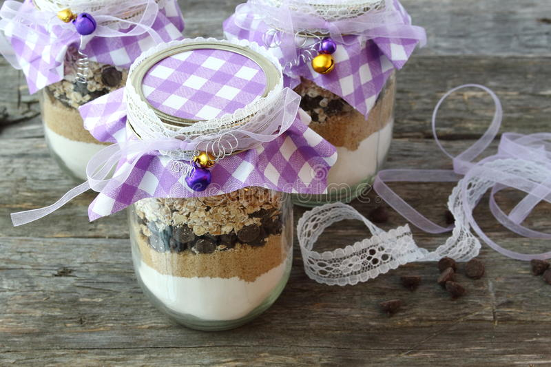 Ingredients for chocolate chip cookies in a jar. Handmade gift royalty free stock photography