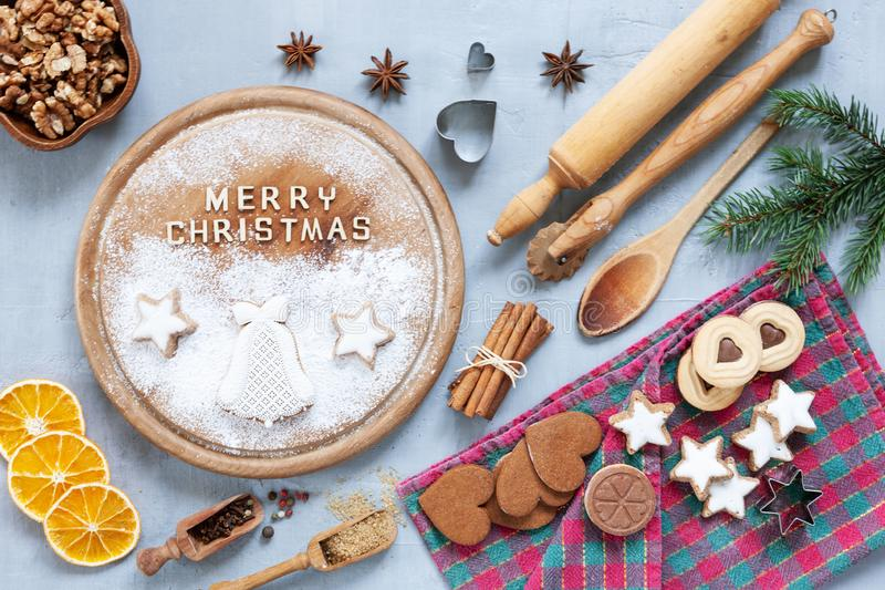 Ingredients for Christmas and Advent Baking, gingerbread. And cookies on concrete light blue table. Top view, close-up. Christmas, New Year concept royalty free stock photography