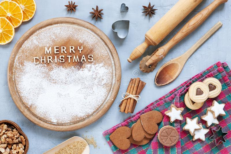 Ingredients for Christmas and Advent Baking, gingerbread. And cookies on concrete light blue table. Top view, close-up. Christmas, New Year concept stock images