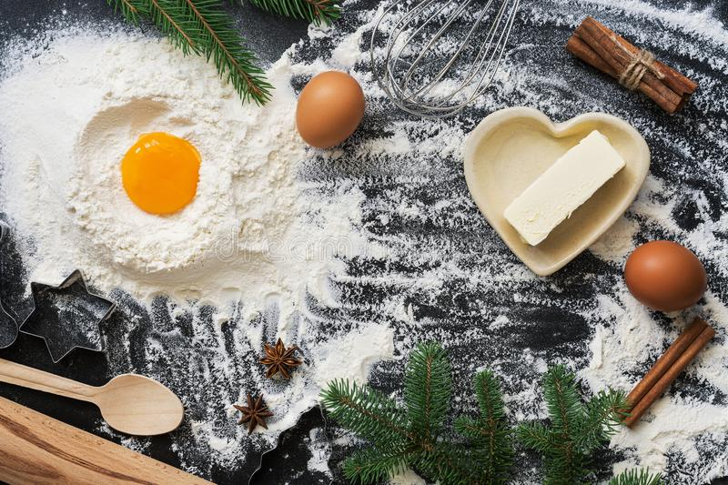 Ingredients for Christmas baking on a dark background. Top view, copy space,flat lay royalty free stock photo