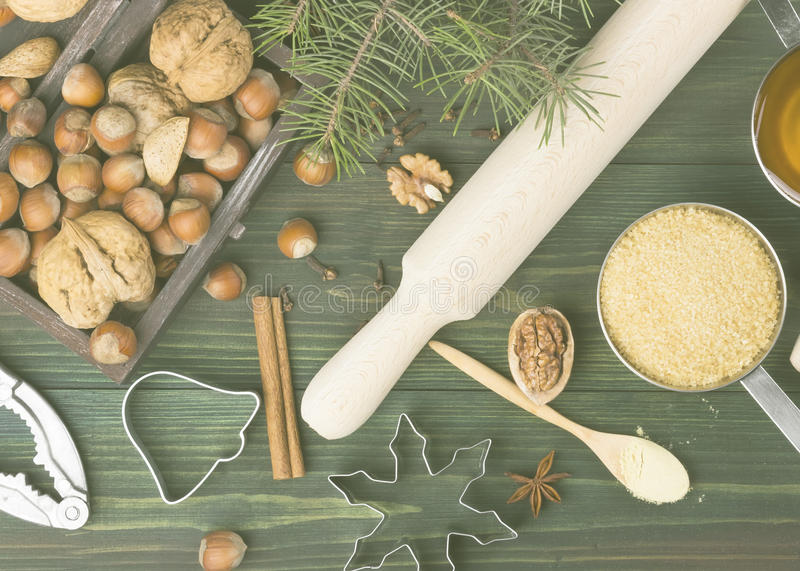 Ingredients for Christmas ginger gingerbreads with honey and cinnamon on a wooden background. Toning stock image