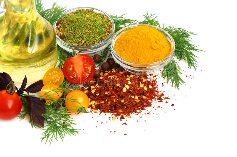 Ingredients for cooking. Cooking oil, spice, tomato and herb leaves on white background royalty free stock photos