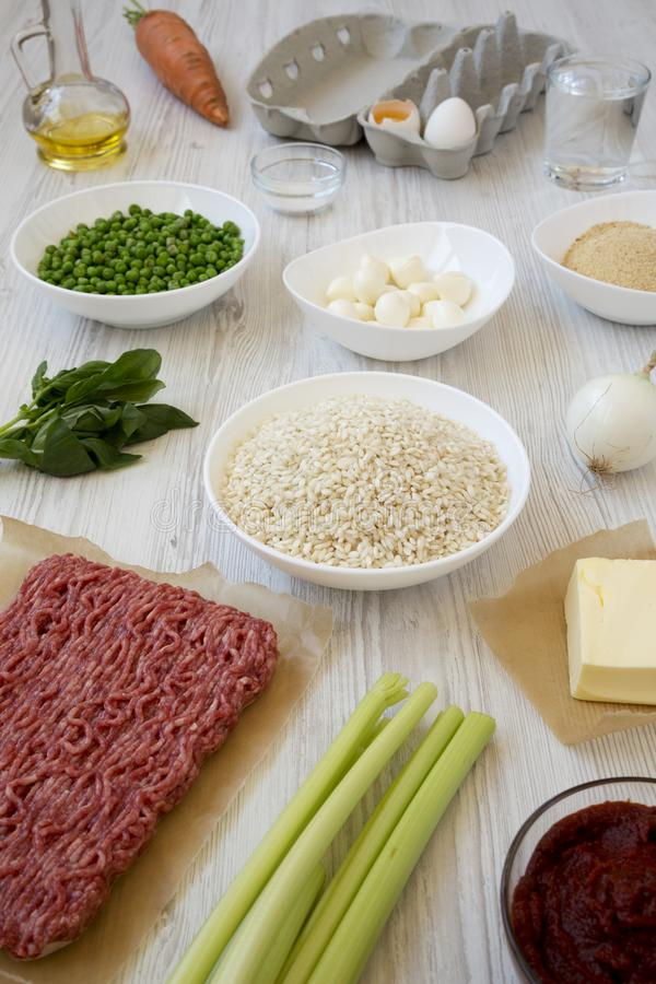 Ingredients for cooking Arancini on a white wooden background, low angle view royalty free stock photo