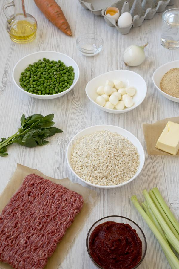 Ingredients for cooking Arancini on a white wooden background, side view. Italian rice balls. Close-up stock images