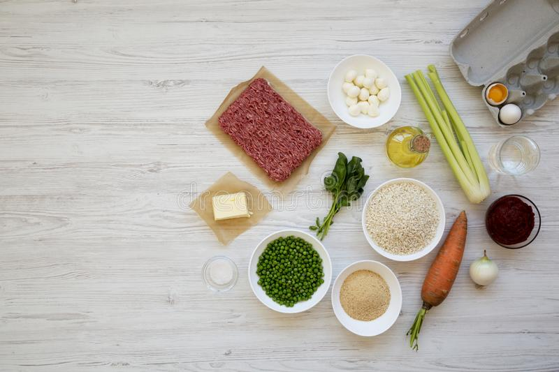 Ingredients for cooking Arancini on a white wooden background, top view. Flat lay, from above, overhead. Copy space royalty free stock photos