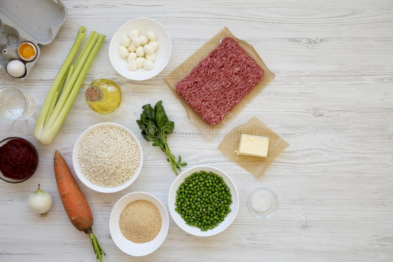 Ingredients for cooking Arancini on a white wooden surface, top view. Flat lay, from above, overhead. Space for text stock photography