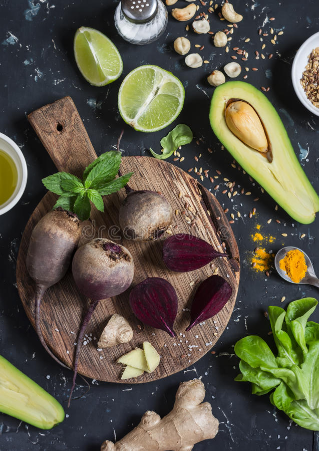 Ingredients for cooking beet and avocado detox salad. On a dark background, top view. royalty free stock image