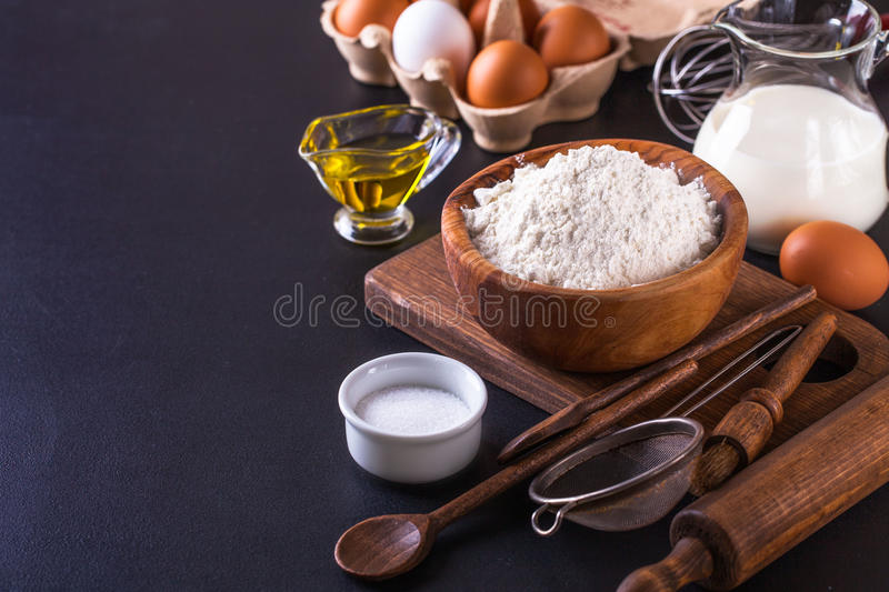 Ingredients for cooking bread on a dark background, horizontal stock photo
