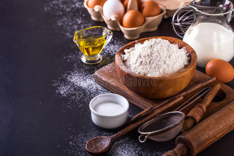 Ingredients for cooking bread on a dark background, horizontal royalty free stock images