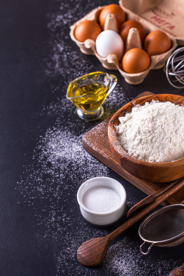 Ingredients for cooking bread on a dark background, vertically royalty free stock photography
