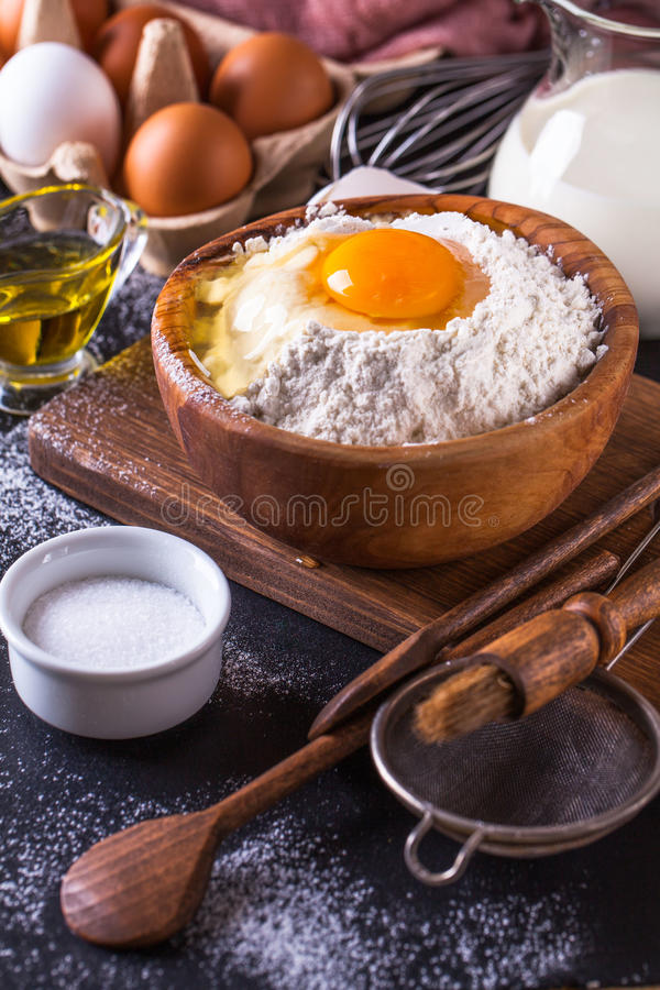 Ingredients for cooking bread on a dark background, vertically stock photography