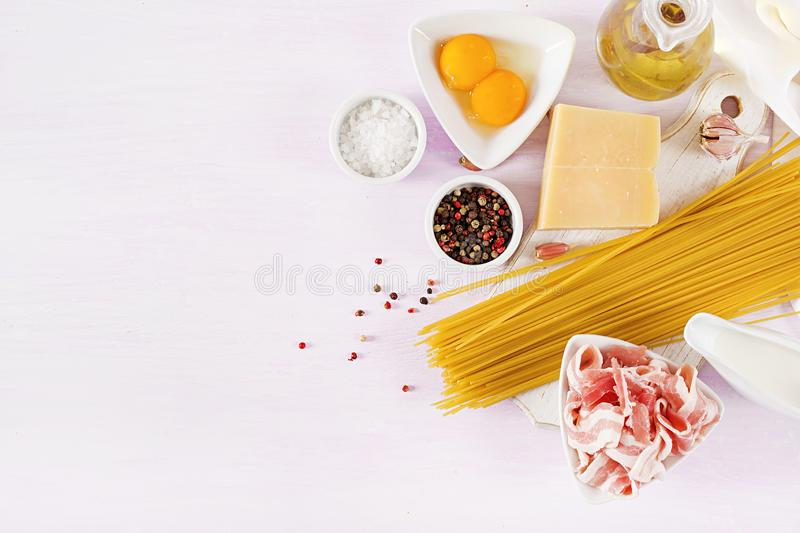 Ingredients for cooking Carbonara pasta, spaghetti with pancetta, egg, peppers stock image