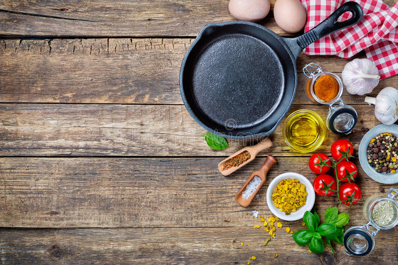 Ingredients for cooking and cast iron skillet royalty free stock photography
