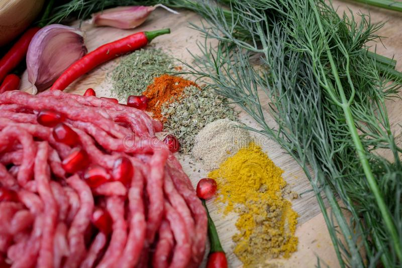 Ingredients for cooking dolma or sarma. fresh meat, vegetables and spices. Close-up royalty free stock photography