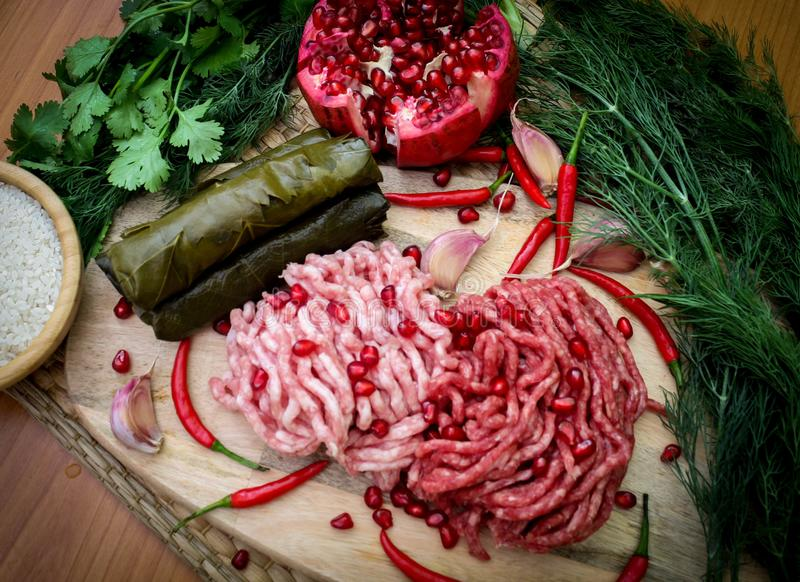 Ingredients for cooking dolma or sarma. fresh meat, vegetables and spices. Close-up stock image