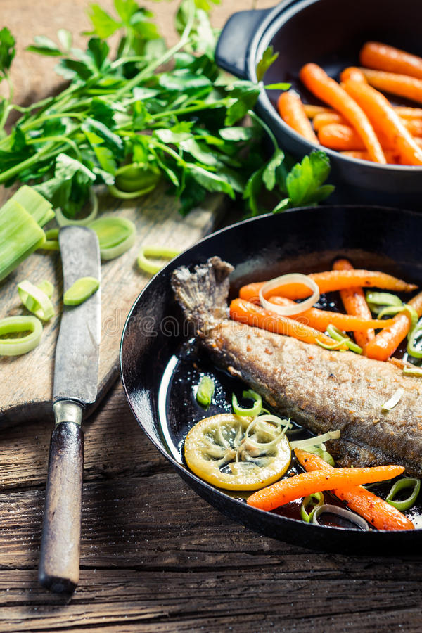 Ingredients for cooking fresh fish in the pan stock image