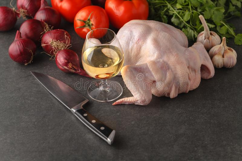 Ingredients for cooking healthy meat dinner. Raw uncooked quail meat with vegetables stock images