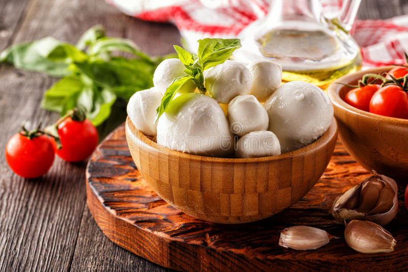 Ingredients for cooking - mozzarella cheese, tomatoes, basil royalty free stock photos