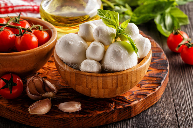 Ingredients for cooking - mozzarella cheese, tomatoes, basil royalty free stock image