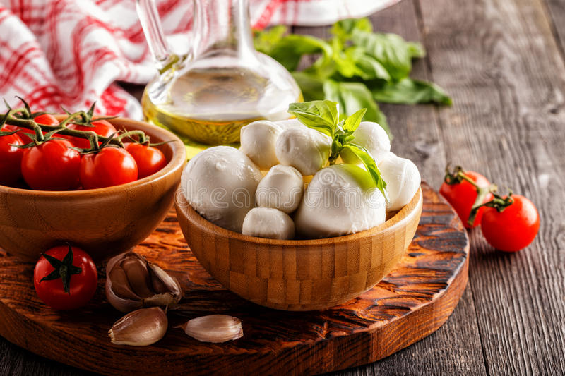 Ingredients for cooking - mozzarella cheese, tomatoes, basil royalty free stock photo