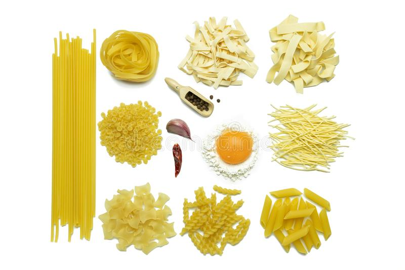 Ingredients for cooking pasta on white background. Fettuccine, tomatoes, spices, flour and egg. stock photography
