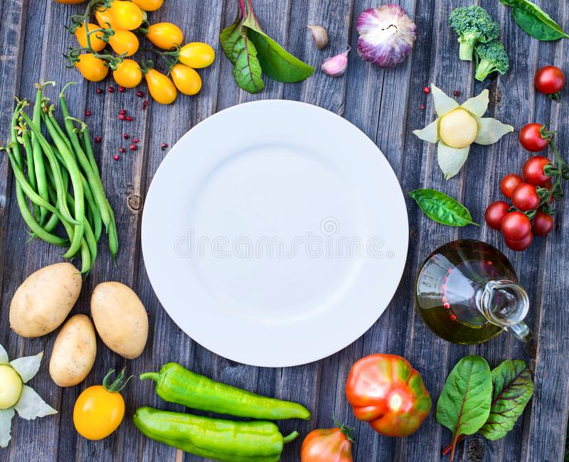 Ingredients for cooking on rustic wooden table around empty whit stock photos