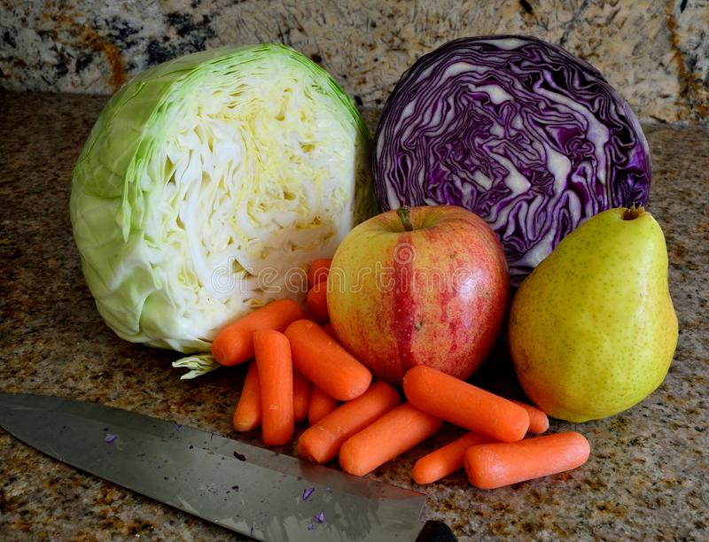 Green and Red Cabbage sliced, carrots, pear, apple, preparing cultured vegetable fruit mix. Ingredients for Cultured or Fermented vegetables, fresh organic green stock images