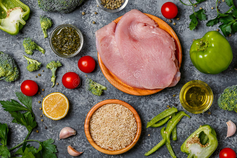 Ingredients for dinner cooking - vegetables, rice and turkey. royalty free stock image
