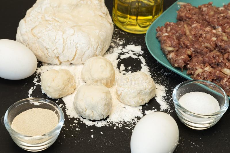 Ingredients for dumplings: dough balls and ground meat stock photography