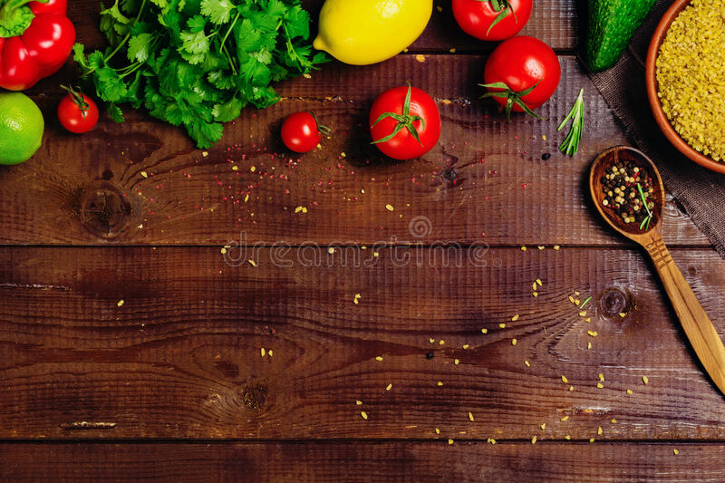 Ingredients food cooking: vegetables, spices, grains. Fresh vegetables, spices and herbs on wooden background with space for text. Healthy ingredients for stock photos