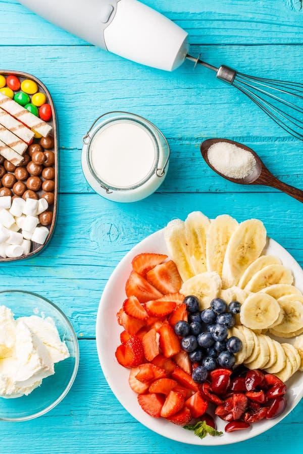 Ingredients for fruit milkshakes. On blue table royalty free stock photo