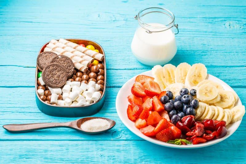Ingredients for fruit milkshakes. On blue table royalty free stock image