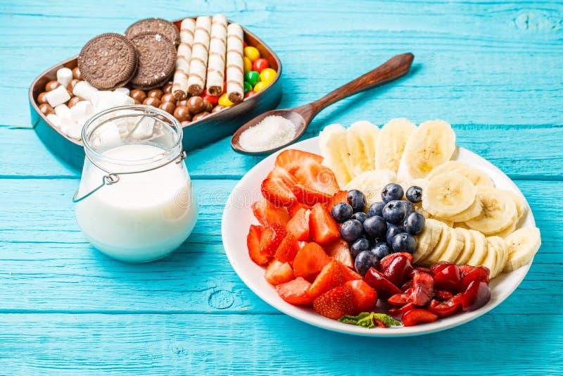 Ingredients for fruit milkshakes. On blue table stock photos